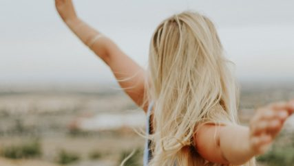 you are enough girl with outstretched arms
