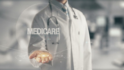 Doctor holding in hand Medicare