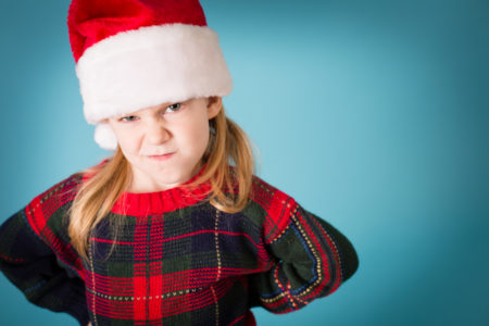 Santa's Grumpy Little Helper Wearing Hat and Christmas Sweater