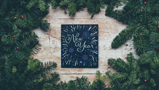 new year chalkboard sign framed by wreath