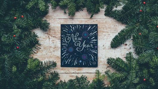 new year chalkboard sign framed by wreath