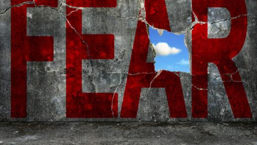 word FEAR on grey wall