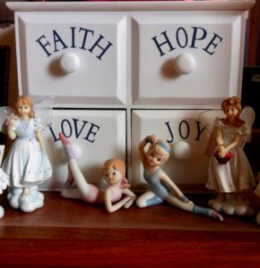 Four drawer chest with Faith, Hope, Love, Joy on each drawer and figurines in front of it