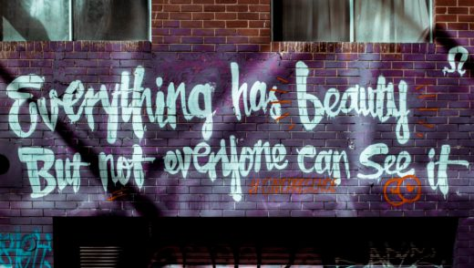 painted on a building: Everything has beauty, but not everyone can see it