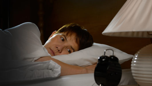 Woman with insomnia lying in bed