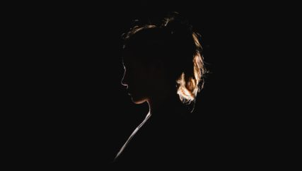 profile of backlit girl