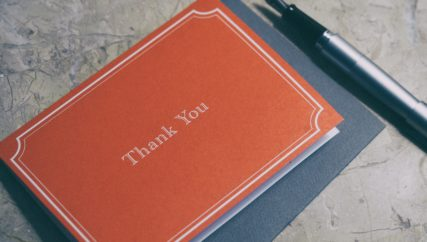 orange thank you card and pen
