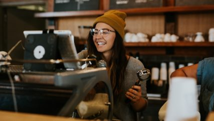 female barista making coffee