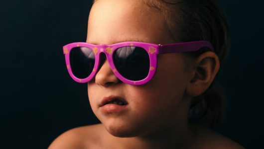 baby in sunglasses with curled lip