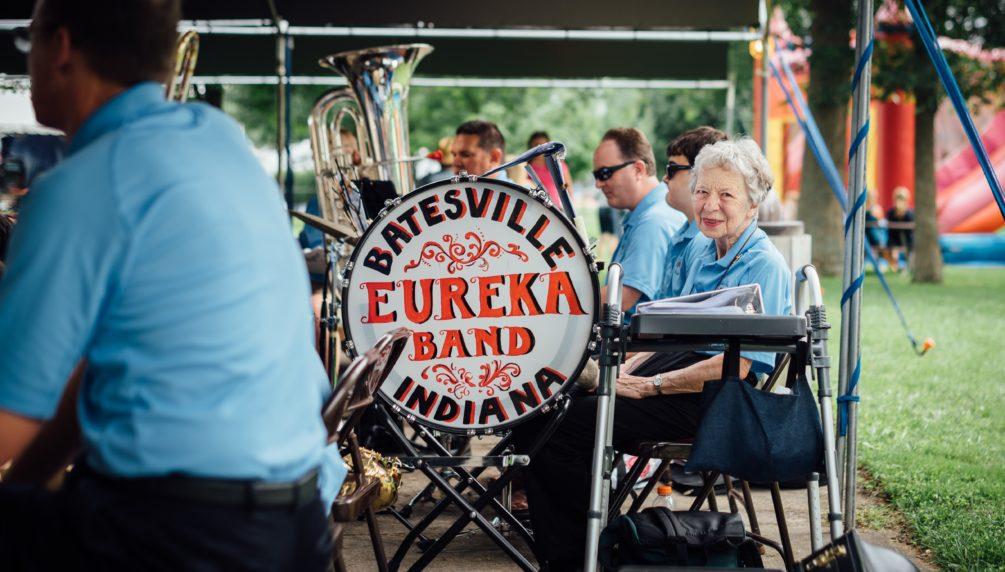 older woman enjoying retirement being part of community band