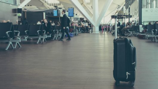 rolling luggage alone in terminal