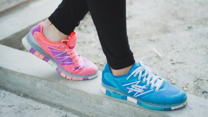 close up of woman walking in sneakers