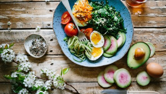 plate with fruits, vegetables, and eggs