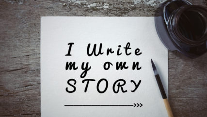 'I write my own story' written on a white piece of paper.