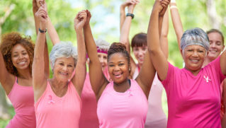 Portrait of a group of enthusiastic woman taking part in a fitness event to raise awareness for breast cancer