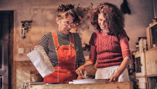 Senior Woman and Mid Adult Woman Preparing Bread Dough.