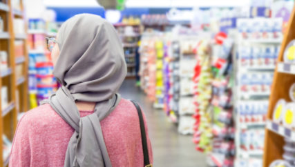 covered women shopping at grocery