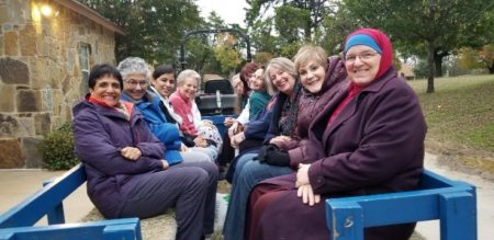 "Diverse women on a ""hayride"""