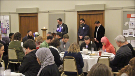 group of religiously diverse people praying together