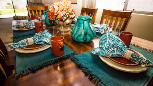 Wooden Table With Six Place Settings, Centerpiece And Pitchers