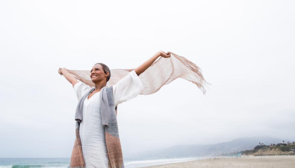 Senior woman enjoying the beach