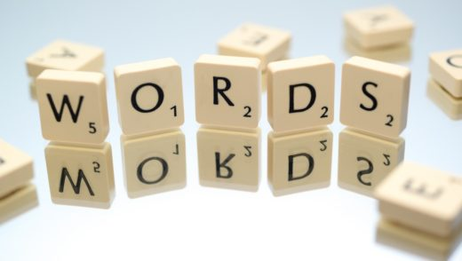 Scrabble tiles spelling out WORDS