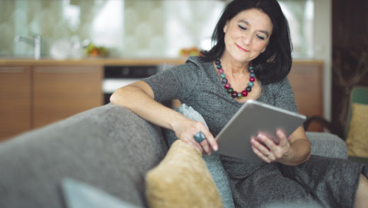 Older woman reading on an e-reader
