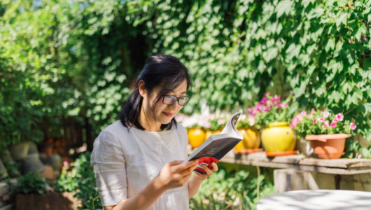 Chinese Woman reading book