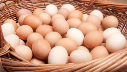 Choline closeup of hundred brown eggs in the basket