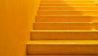 One Step at a time Yellow Wall and Steps Background