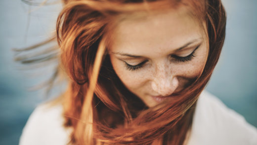 Portrait of young red haired woman