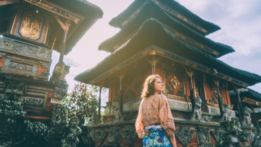 Young Caucasian woman walking in Balinese temple, Indonesia